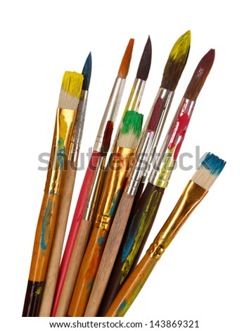 Many brush in paint closeup isolated on white - stock photo