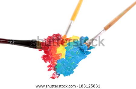 Many brushes in paints isolated on white