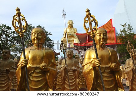 Many Buddha Golden Statues in Thailand - stock photo