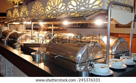 Many Buffet Heated Trays in Luxury Restaurant. Buffet food. Self-service restaurant.All inclusive - stock photo