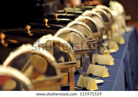 Many buffet heated trays ready for service. - stock photo