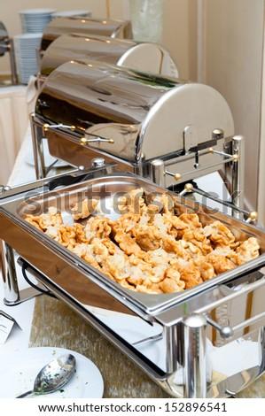 Many buffet heated trays ready for service - hot dumplings - stock photo