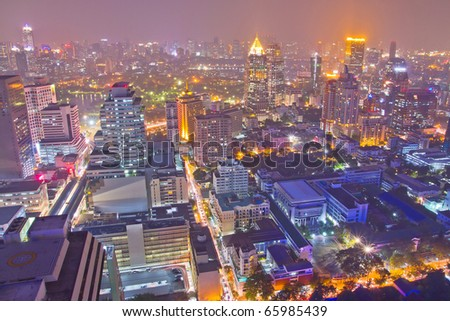 many buildings in business area in Bangkok at night, thailand - stock photo