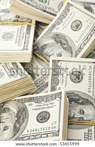 Many  bundle of US 100 dollars bank notes - stock photo