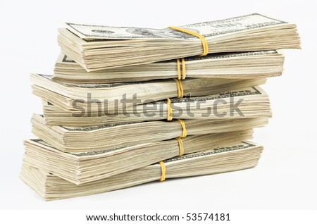 Many  bundle of US 100 dollars bank notes isolated  on white background - stock photo