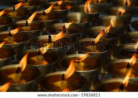 Many burning candles - stock photo