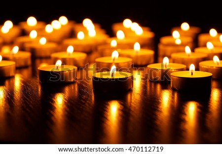 Many burning candles with shallow depth of field - peace concept