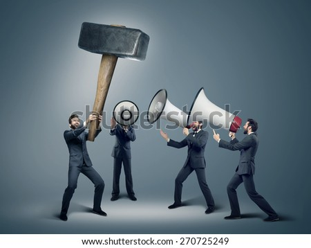 Many businessmen with megaphones - stock photo