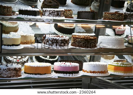 Many Cakes with cherries and chocolate in cafe