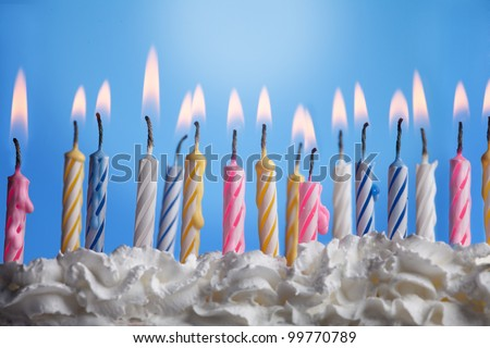 Many candels in birthday cake - stock photo