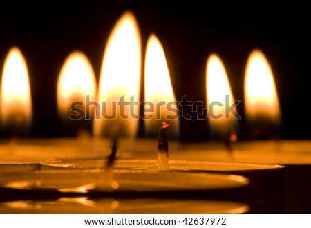 Many candles light in darkness - stock photo