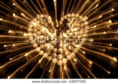 many candlestick encrusted heart shape dark background - stock photo