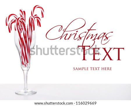 Many Candy canes in a wine glass  with an isolated white background - stock photo