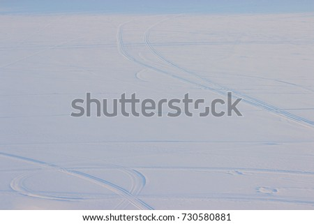 many Car tire track in snow. high angle