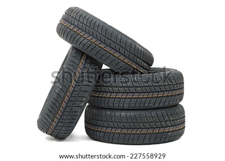 Many car tyres in a pile - stock photo