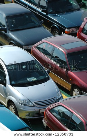 Many cars in lines - stock photo