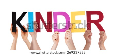 Many Caucasian People And Hands Holding Colorful Straight Letters Or Characters Building The Isolated German Word Kinder Which Means Kids On White Background - stock photo