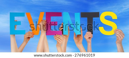 Many Caucasian People And Hands Holding Colorful Straight Letters Or Characters Building The English Word Events On Blue Sky - stock photo