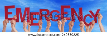 Many Caucasian People And Hands Holding Red Letters Or Characters Building The English Word Emergency On Blue Sky - stock photo