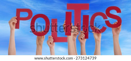 Many Caucasian People And Hands Holding Red Letters Or Characters Building The English Word Politics On Blue Sky - stock photo