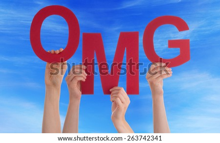 Many Caucasian People And Hands Holding Red Letters Or Characters Building The English Word OMG On Blue Sky - stock photo