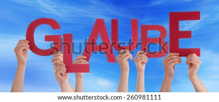 Many Caucasian People And Hands Holding Red Letters Or Characters Building The German Word Glaube Which Means Belief On Blue Sky - stock photo