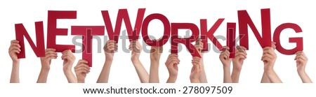 Many Caucasian People And Hands Holding Red Letters Or Characters Building The Isolated English Word Networking On White Background - stock photo