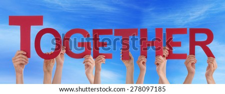 Many Caucasian People And Hands Holding Red Straight Letters Or Characters Building The English Word Together On Blue Sky - stock photo