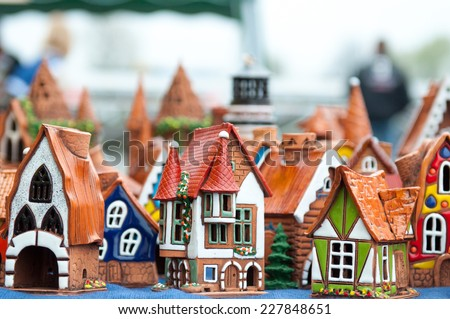Many ceramic toys for children. Souvenirs. Building houses and lighthouses. - stock photo