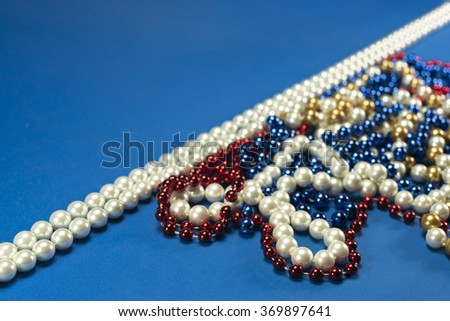 Many chains of white, red and blue pearls on blue backgrounds - stock photo