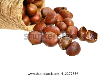 Many chestnuts in small sack isolated on white background - stock photo