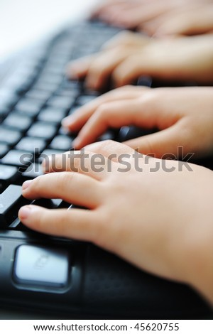 Many children hands typing - stock photo