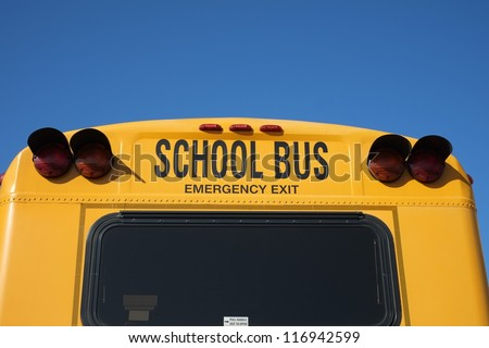 Many children rely on the iconic yellow school bus for transportation - stock photo