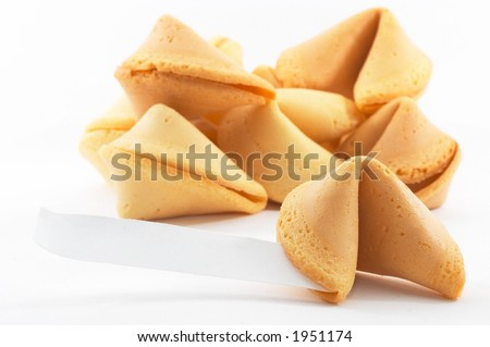 Many Chinese fortune cookies stacked up, one stand out, on white background, side view, with a white piece of paper for entering text/fortune - stock photo