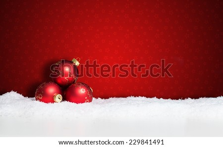 many christmas balls in the snow - stock photo