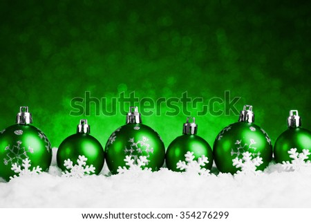 many christmas balls in the snow. studio shot