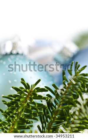 Many Christmas decorations laying in pine branches