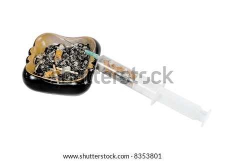 many cigarette butts in ash-tray and syringe isolated on white