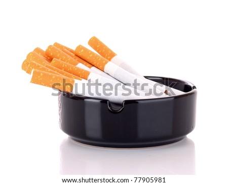 Many cigarettes isolated on white - stock photo