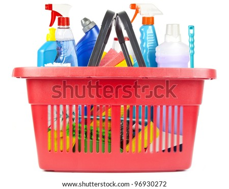 Many cleaning tools and products in shopping basket - stock photo