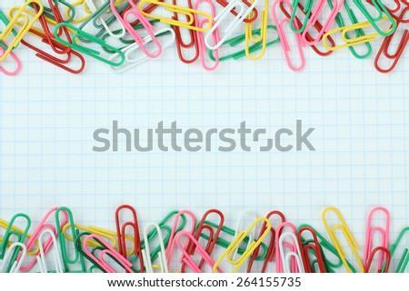 many clips on notebook - stock photo