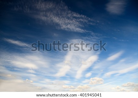 many clouds in a blue sky - stock photo