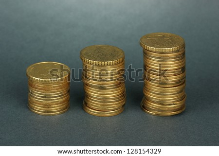 Many coins in columns on grey background