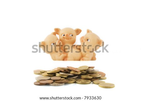 many coins saved with happy piggybank in the background - stock photo