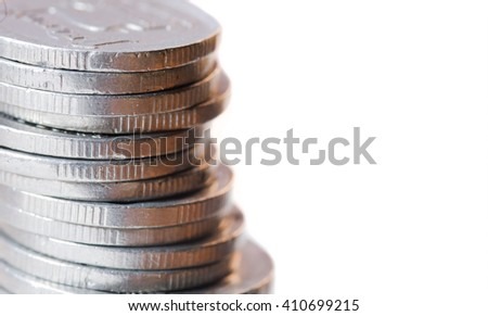 Many coins stacked on one another
