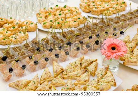 many cold snacks on buffet table, catering - stock photo