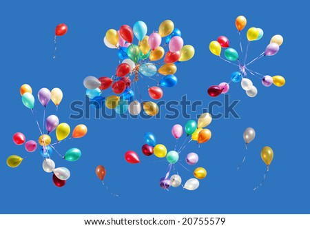 Many color balloons isolated on blue - stock photo