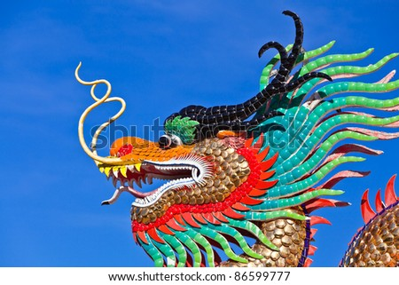 many color dragons on blue sky - stock photo