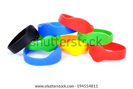 many color rfid bracelet on a white background - stock photo