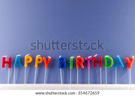 Many Colored Candles with Text Happy Birthday - stock photo